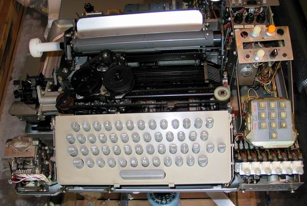 A front view of the ASR33 teletype with the cover off showing the inner workings